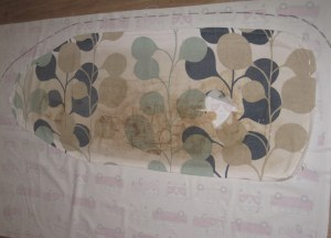 Lay out old cover on fabric & trace around with a 5cm seam allowance