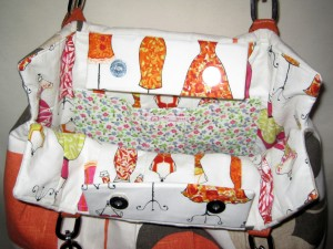 Some fun - fashion lady lining in pink and orange.  Sure to bring a smile to your face, every time you open your bag.