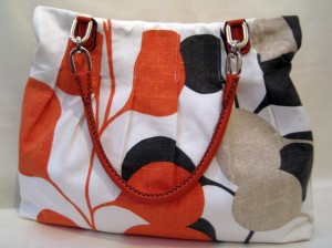 Harlequin Pod with matching Orange leather handle.